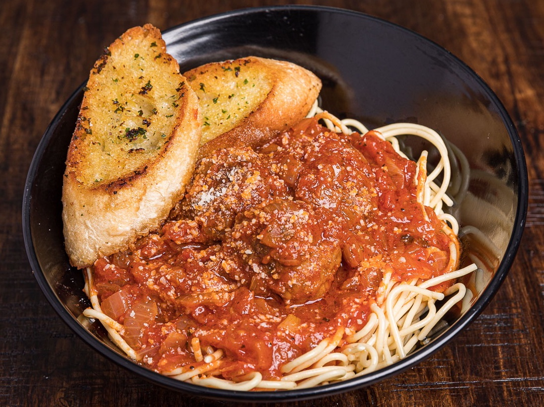 Spaghetti & Meatballs served with garlic bread